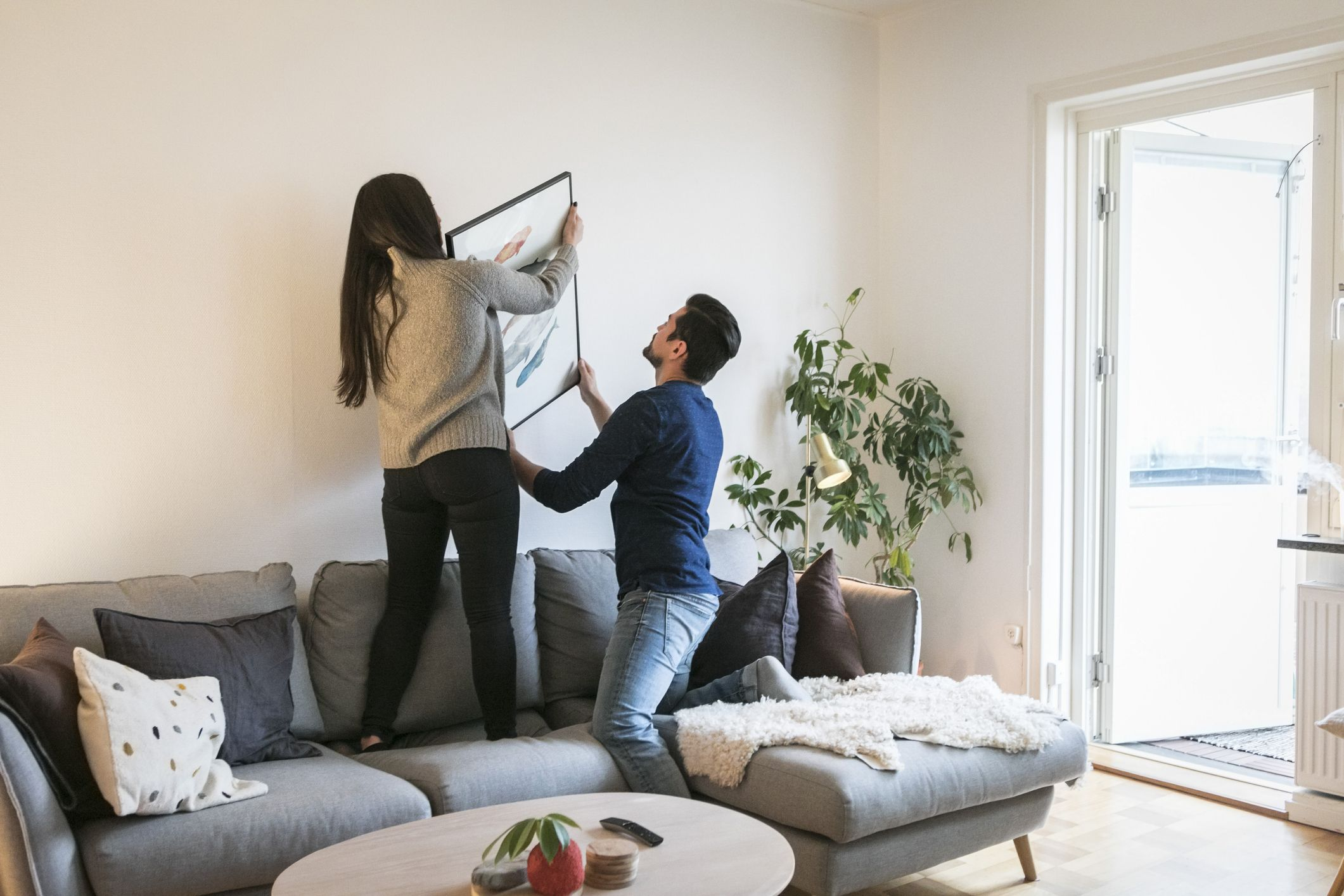 couple decorating the interior of their house