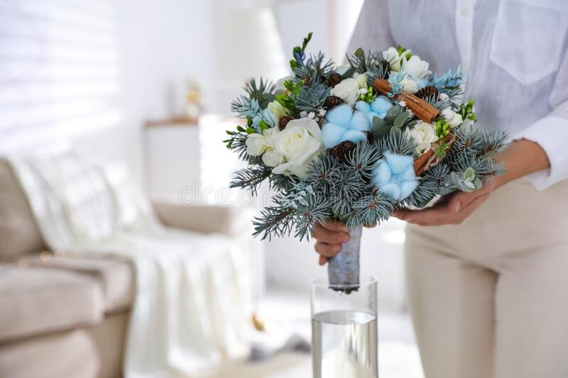person placing flowers in a vase